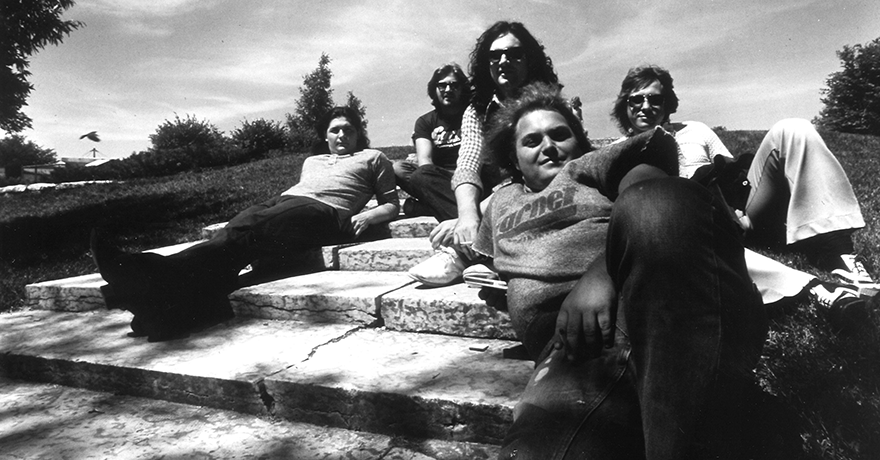 Photo of The Guess who sitting on a hill