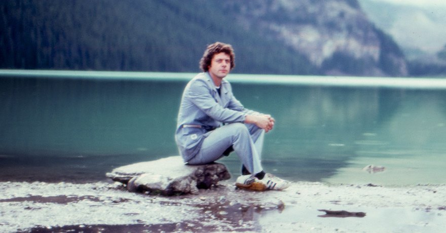 Allister MacGillivray sitting along the water