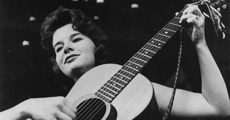 Vintage photo of Bonnie Dobson with acoustic guitar